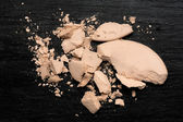Crushed Compact Powder on Blackboard — Stock Photo