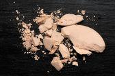 Crushed Compact Powder on Blackboard — Stock Photo