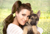 Happy Young Woman with a Puppy Dog — Stock Photo