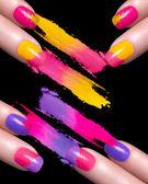 Red Nail Polish and Mineral Colorful Eye Shadow — Stock Photo
