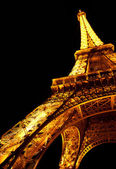 PARIS - MAY 09 The Eiffel tower at night on May 09, 2012 in Paris. The Eiffel tower is the most visited monument of France. — Stock Photo