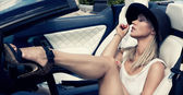 Sexy lady in the sport car — Stock Photo