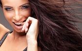 Portrait of beautiful happy brunette woman — Stock Photo