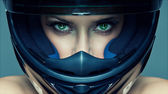 Sexy woman in helmet on blue background — Stockfoto