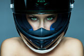 Sexy woman in helmet on blue background — Photo