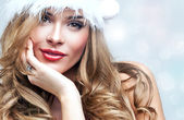 Beautiful happy woman in Santa Claus clothes — Stock Photo