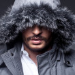 Close up portrait of winter man on grey background — Stock Photo