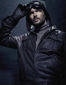 Portrait of young man wearing aviator headgear — Stock Photo