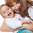 Beautiful smiling mum hugging her child — Stock Photo