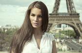 Sepia photo of fashion woman in romantic city — Stock Photo