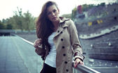 Beautiful young woman wearing coat — Stock Photo