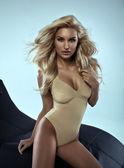 Sexy blonde woman in studio — Stock Photo