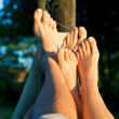 Foot of couple on hammock enjoying sun — Stock Photo
