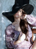 Woman with black hat — Stock Photo
