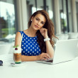 Beautiful smiling woman working on laptop — Stock Photo