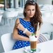 Beautiful woman with iced coffee — Stock Photo