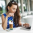 Beautiful business woman browsing the internet — Stock Photo
