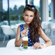 Attractive woman drinking iced coffee — Stock Photo