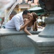 Couple in love kissing each other at the fountain — Stock Photo #30166849