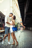 Couple in love kissing each other in city center — Stock Photo