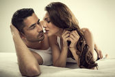 Handsome man and sexy woman in bed — Stock Photo