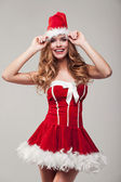 Happy woman wearing santa clause costume — Stock Photo