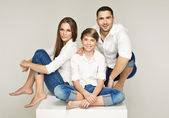 Happy young family with pretty child — Stock Photo