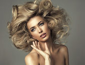Beautiful blond woman with curly long hair — Stock Photo