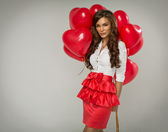 Portrait of beautiful woman with red balloon heart — Stock Photo