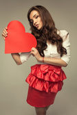 Kissing woman with heart — Stock Photo