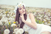 Woman lying on a meadow — Stock Photo