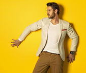 Model on yellow background — Stock Photo