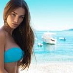 Brunet beauty in blue swimwear — Stock Photo #47988575