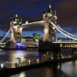 Tower Bridge by night, London, UK - Stock Photo