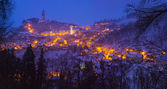 Snowy evening view of the lighted town — Stock Photo