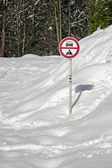 Snowy road with sign no entry — Stok fotoğraf