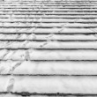 Tracks on snowy stairs - background - Stock Photo