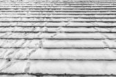 Tracks on snowy stairs - background — Stock Photo