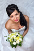Beautiful bride with bouquet - from above — ストック写真