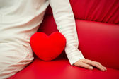 Lonely heart on sofa - Valentine and loneliness — Stock Photo