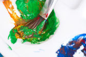 Close-up of paint brush and palette — Stock Photo