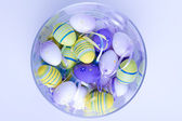 Easter eggs in glass vase — Photo