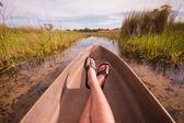 Man relaxing in a canoe point of view — Stock Photo