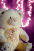 Soft teddy bear with bokeh lights — Stock Photo