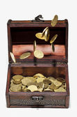 Coins in the air and in a box — 图库照片