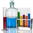 Assorted laboratory glassware equipment with color liquids - Stock Photo