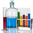 Assorted laboratory glassware equipment with color liquids — Stock Photo