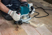 Using an electric router — Stock Photo