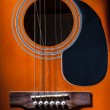 Guitar with broken strings — Stock Photo