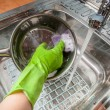 Woman washing dishes in the sink — Stock Photo